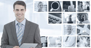 Composite image of businessman using a tablet  with colleagues behind in office Stock Photo