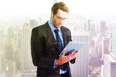 Composite image of businessman using a tablet computer Stock Photos