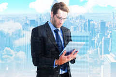 Composite image of businessman using a tablet computer Royalty Free Stock Photos
