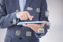 Composite image of businessman using tablet pc Royalty Free Stock Image