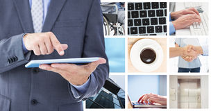 Composite image of businessman using tablet pc stock image
