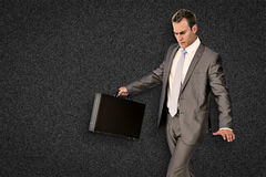 Composite image of businessman walking with his briefcase Stock Image