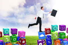 Composite image of businessman walking with his briefcase Stock Images