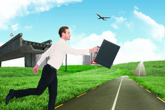 Composite image of businessman walking with his briefcase Royalty Free Stock Photo