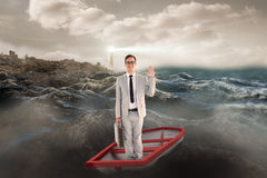Composite image of businessman waving in boat Royalty Free Stock Photography