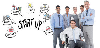 Composite image of businessman in wheelchair with his colleagues looking at camera Stock Photography