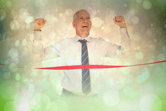 Composite image of businessman winning race Royalty Free Stock Photos