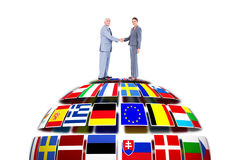 Composite image of businessman and woman shaking hands Stock Images