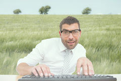 Composite image of businessman working at his desk Royalty Free Stock Photos