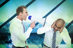 Composite image of businessman yelling with a megaphone at his colleague Stock Photography