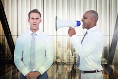 Composite image of businessman yelling with a megaphone at his colleague. Businessman yelling with a megaphone at his colleague against window overlooking citty Stock Images
