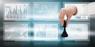 Composite image of businessmans hand moving black king Stock Image