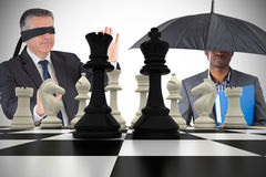 Composite image of businessmen with chessboard Royalty Free Stock Photos