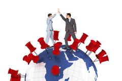 Composite image of businessmen high fiving Stock Photo