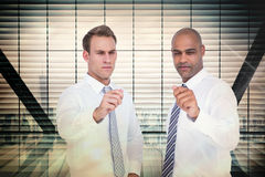 Composite image of businessmen pointing something with their hands Royalty Free Stock Photography