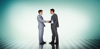Composite image of businessmen shaking hands Royalty Free Stock Images
