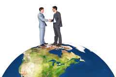 Composite image of businessmen shaking hands Stock Images