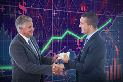 Composite image of businessmen shaking hands and exchanging money. Businessmen shaking hands and exchanging money against red arrow stock photo