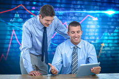 Composite image of businessmen using tablet Royalty Free Stock Photography