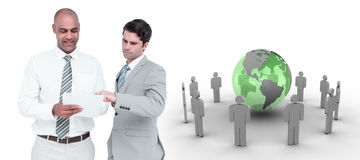 Composite image of businessmen working together Royalty Free Stock Photo