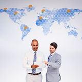 Composite image of businessmen working together Royalty Free Stock Photography