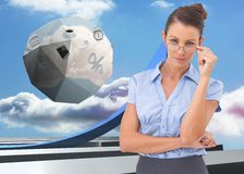 Composite image of businesswoman adjusting her glasses Royalty Free Stock Images