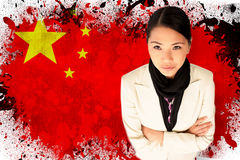 Composite image of businesswoman with arms folded Royalty Free Stock Photography
