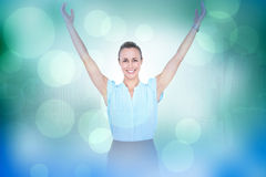Composite image of businesswoman with arms raised Stock Images