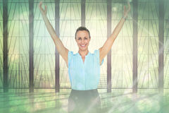 Composite image of businesswoman with arms raised Royalty Free Stock Image