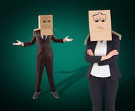 Composite image of businesswoman with box over head. Businesswoman with box over head against green background with vignette Stock Photos