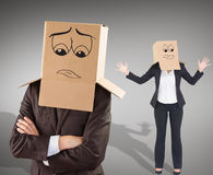 Composite image of businesswoman with box over head. Businesswoman with box over head against grey vignette Stock Image