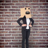Composite image of businesswoman with box over head Stock Photo