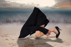 Composite image of businesswoman burying her head Royalty Free Stock Image