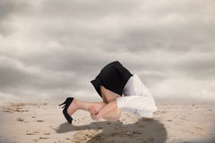 Composite image of businesswoman burying her head Stock Image