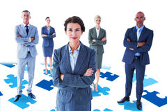 Composite image of businesswoman colleagues arm crossed Stock Photo
