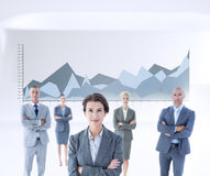 Composite image of businesswoman colleagues arm crossed Stock Photos