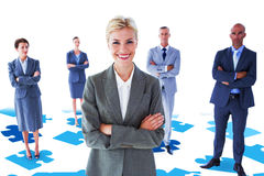 Composite image of businesswoman colleagues arm crossed Stock Photography