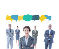 Composite image of businesswoman colleagues arm crossed Royalty Free Stock Photos