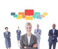 Composite image of businesswoman colleagues arm crossed Royalty Free Stock Image