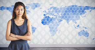 Composite image of businesswoman with crossed arms Royalty Free Stock Photo