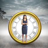 Composite image of businesswoman with crossed arms. Businesswoman with crossed arms against misty forest Stock Photo