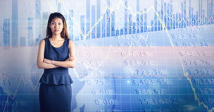 Composite image of businesswoman with crossed arms. Businesswoman with crossed arms against stocks and shares Stock Images