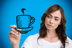 Composite image of businesswoman drawing coffee cup Royalty Free Stock Image