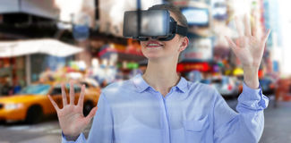Composite image of businesswoman experiencing virtual reality Stock Photography