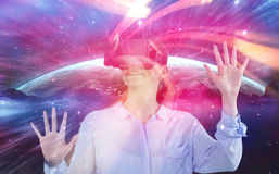Composite image of businesswoman experiencing virtual reality Royalty Free Stock Photo