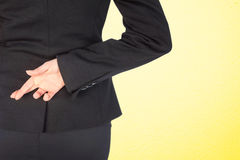 Composite image of businesswoman with fingers crossed behind her back Royalty Free Stock Photo
