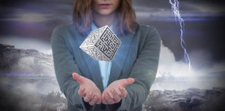 Composite image of businesswoman gesturing against apocalyptic background Stock Photo