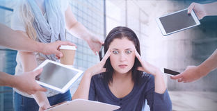 Composite image of businesswoman having headache Royalty Free Stock Images