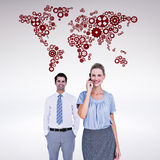 Composite image of businesswoman having phone call while her colleague posing Stock Photo