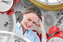 Composite image of businesswoman with headache Stock Image